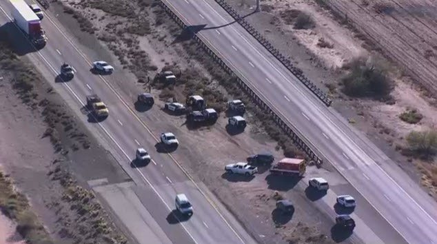 The chase came to an end when the stolen truck driven by a naked woman crash near Eloy. (Source: KPHO/KTVK)
