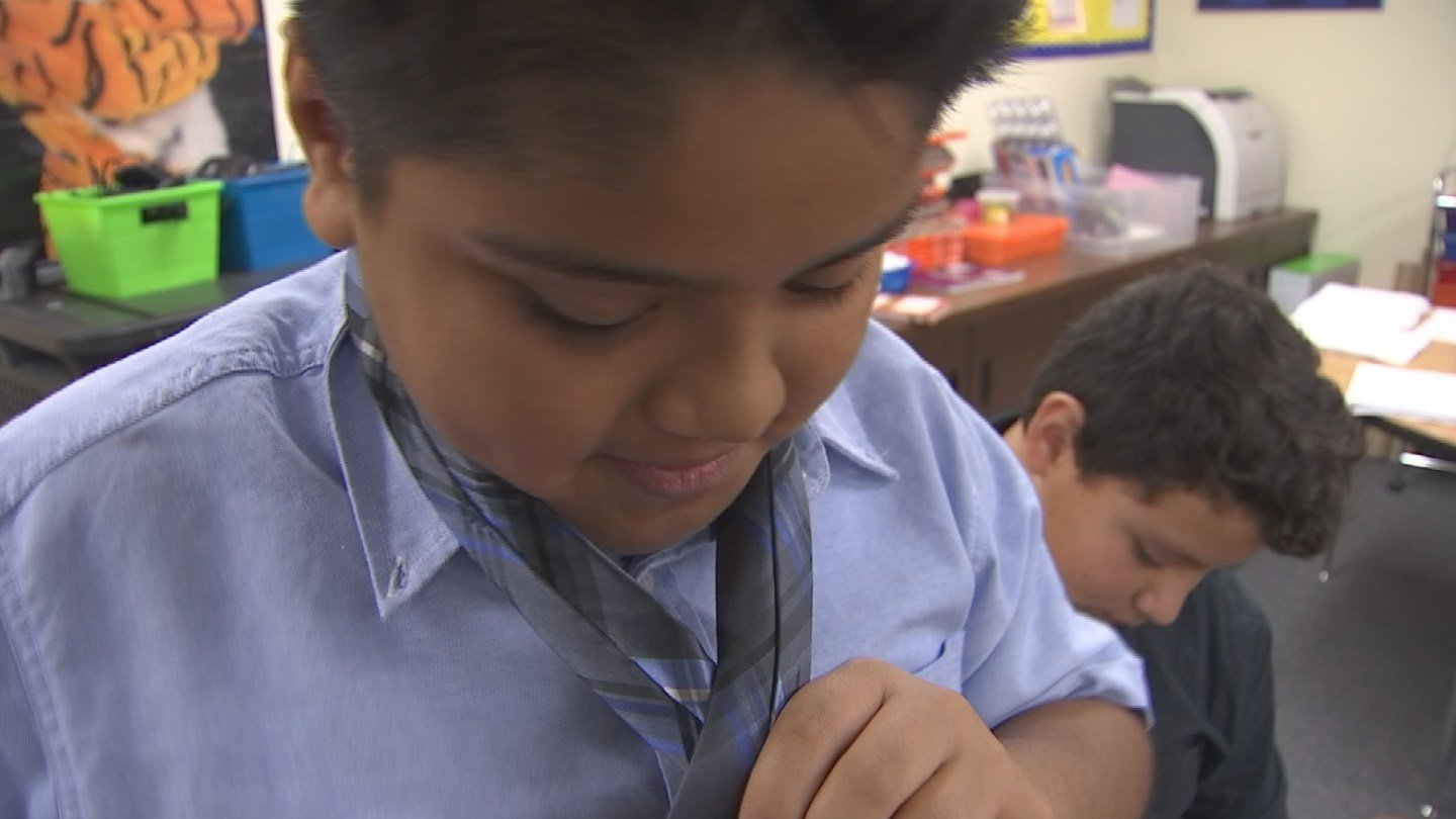 The kids learn how to tie a tie in the club. (Source: 3TV/CBS 5)