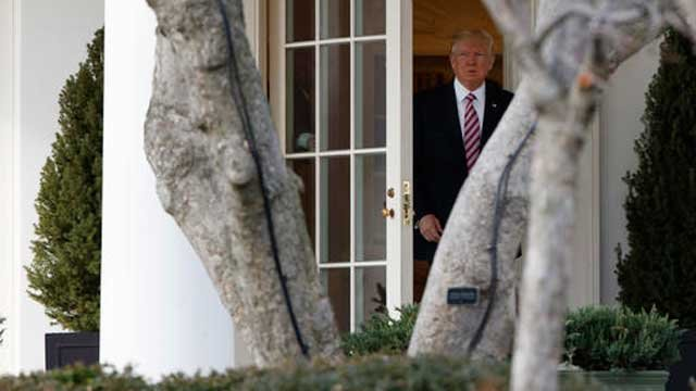 President Donald Trump leaves the Oval Office to board Marine One on the South Lawn of the White House in Washington, Thursday, Jan. 26, 2017. (Source: AP Photo/Evan Vucci)