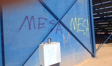 "Westwood High School in Mesa was vandalized overnight. Someone spray-painted ""MESA"" on the football field, the ticket booth and the  area around the bleachers. By Jennifer Thomas"