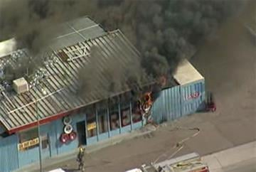 A tire shop on Glendale Avenue at Interstate 17 burned Thursday morning. By Jennifer Thomas