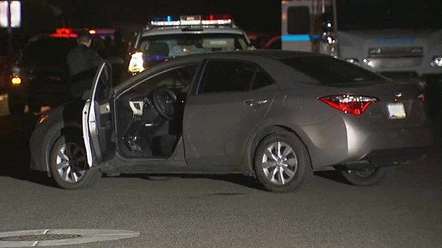 Police continue their investigation into the fatal shooting of a man police said stabbed a woman driving this car in Phoenix late Sunday night. (Source: KPHO/KTVK)
