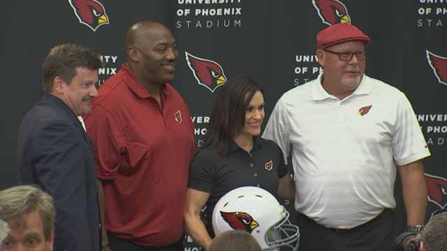Arizona Cardinals training camp coach Dr. Jen Welter poses for photographers after being introduced, Tuesday, July 28, 2015, at the teams' training facility in Tempe, Ariz. (Source: KPHO/KTVK)