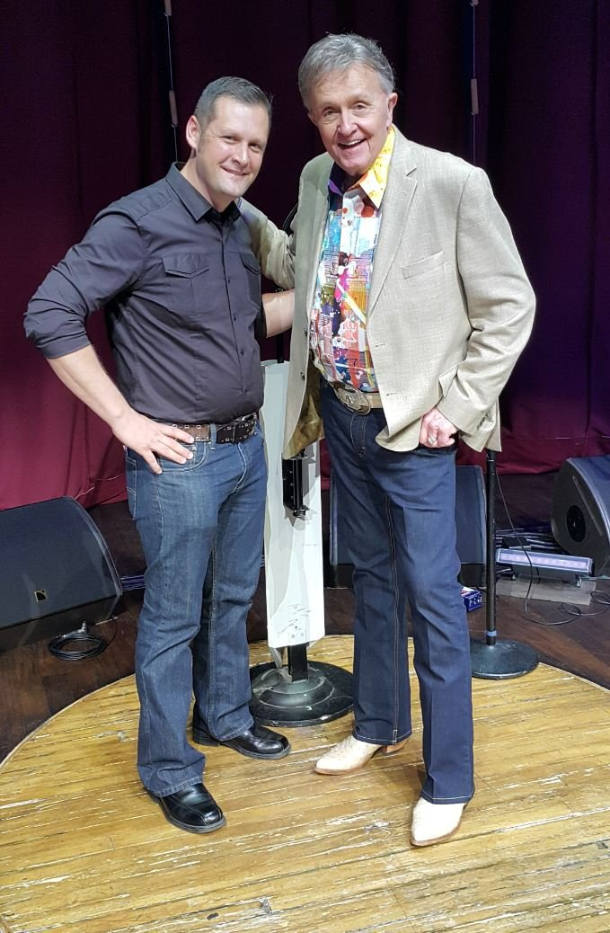 Pawn Shop owner Mike Grauer returns guitar to country music legend Bill Anderson