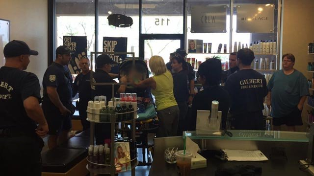 Gilbert police officers and firefighters spent about 30 minutes with the baby in the salon. He never cried. (Souce: KPHO/KTVK)