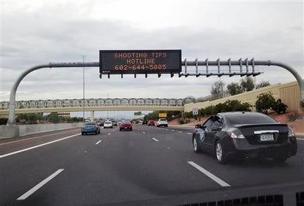 An Arizona Department of Transportation sign gives a hotline number for information on the recent freeway shootings on Wednesday, Sept. 9, 2015. (Source: AP Photo/Traci Carl)