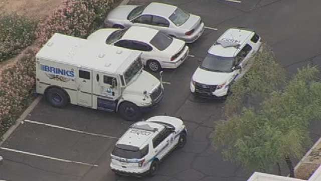 Authorities are looking at the damage to an armored truck at I-10 and Elliot Road. (Source: KPHO/KTVK)