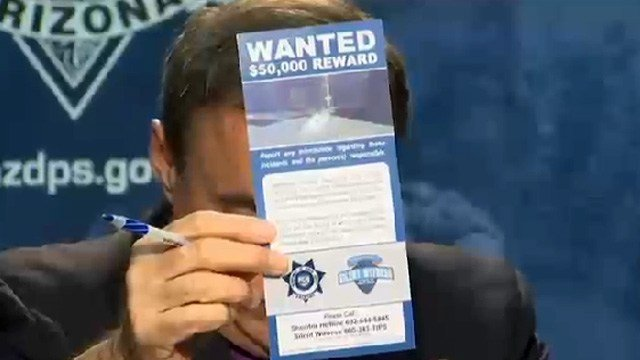 DPS spokesman Bart Graves holds up one of the fliers (Source: KPHO/KTVK)
