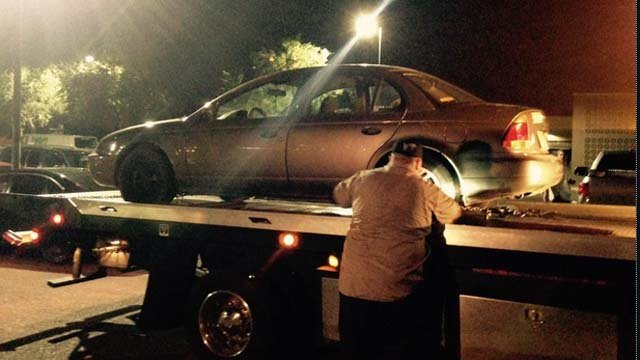 Suspect's car being towed from the Wal-Mart parking lot. (Source: Amanda Goodman, KPHO/KTVK)