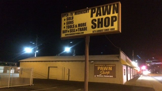 Mo Money Pawn Shop, where staffers were contacted by detectives from the Arizona Department of Public Safety asking for our cooperation in finding a certain caliber and make of handgun. (Source: KPHO/KTVK)