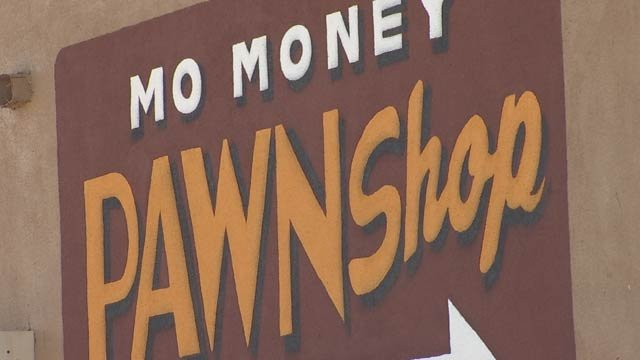 The owner and the general manager of Mo Money Pawn Shop said Merritt's gun was not in their possession on Aug. 29, when three of the shootings occurred. (Source: KPHO/KTVK)
