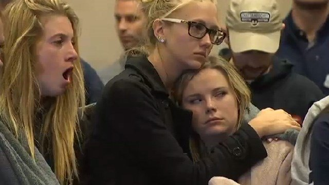 Many hugged each other while waiting for the news briefing to begin. (Source: KPHO./KTVK)