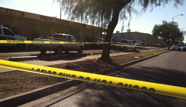 Crime tape and a police vehicle at the scene of a deadly shooting on West Van Buren in Phoenix on Monday, Oct. 26. (Source: KPHO/KTVK)