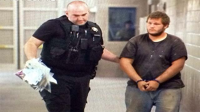 Merritt in handcuffs as he was booked into jail. (Source: KPHO/KTVK)
