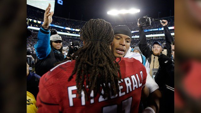 Carolina Panthers' Cam Newton talks to Arizona Cardinals' Larry Fitzgerald after the NFL football NFC Championship game Sunday, Jan. 24, 2016, in Charlotte, N.C. The Panthers won 49-15 to advance to the Super Bowl. (Source: AP Photo/Chuck Burton)