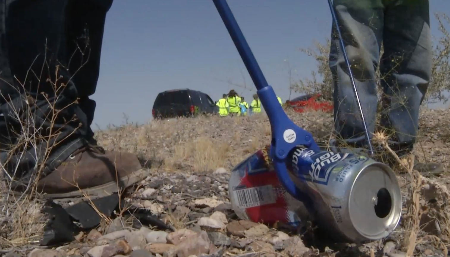 Volunteers for the Adopt a Highway program pick up a beer can along an Arizona highway. (Source: Arizona Department of Transportation)