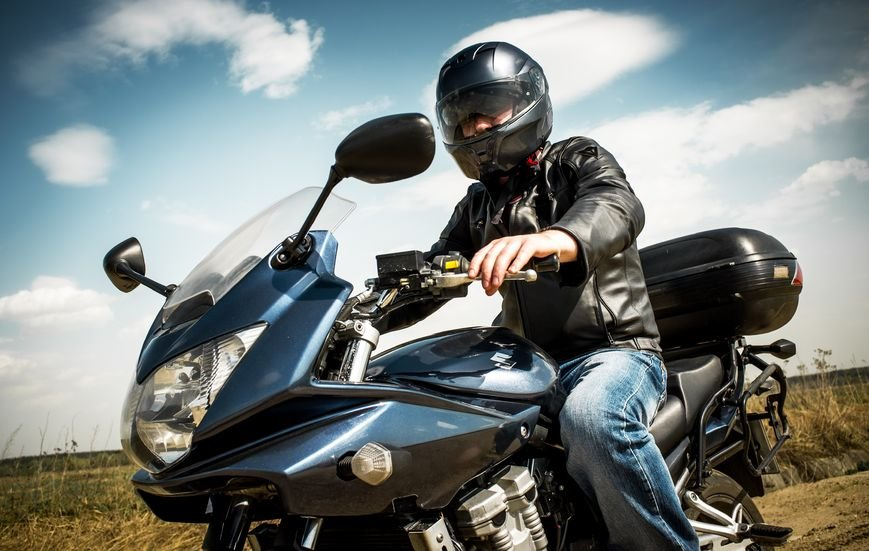 Current Arizona law only requires motorcycle riders under 18 to wear a helmet. (Source:  Andrey Armyagov via 123 RF)