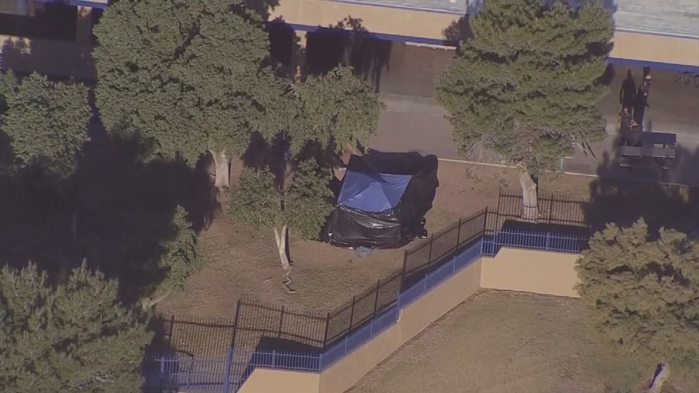 A blue popup canopy covers the scene of the murder-suicide at Independence High School in Glendale, AZ (Source: KPHO/KTVK)
