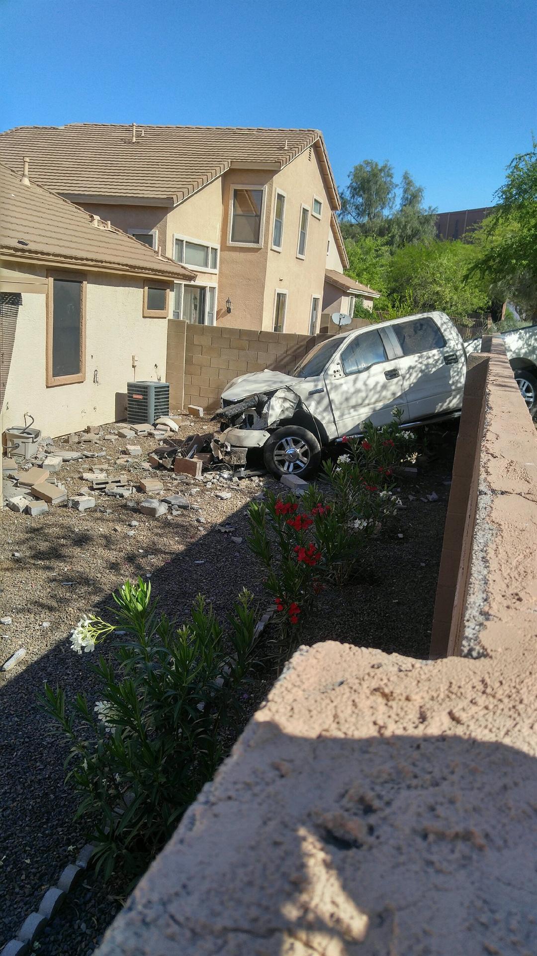 driver crashes through backyard wall in mesa fox carolina 21