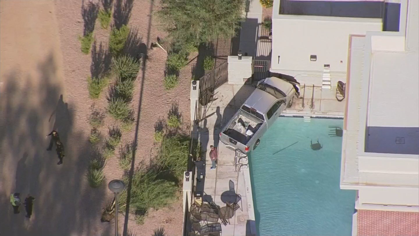 Crash ends with truck nearly in tempe pool for Pool show florence sc