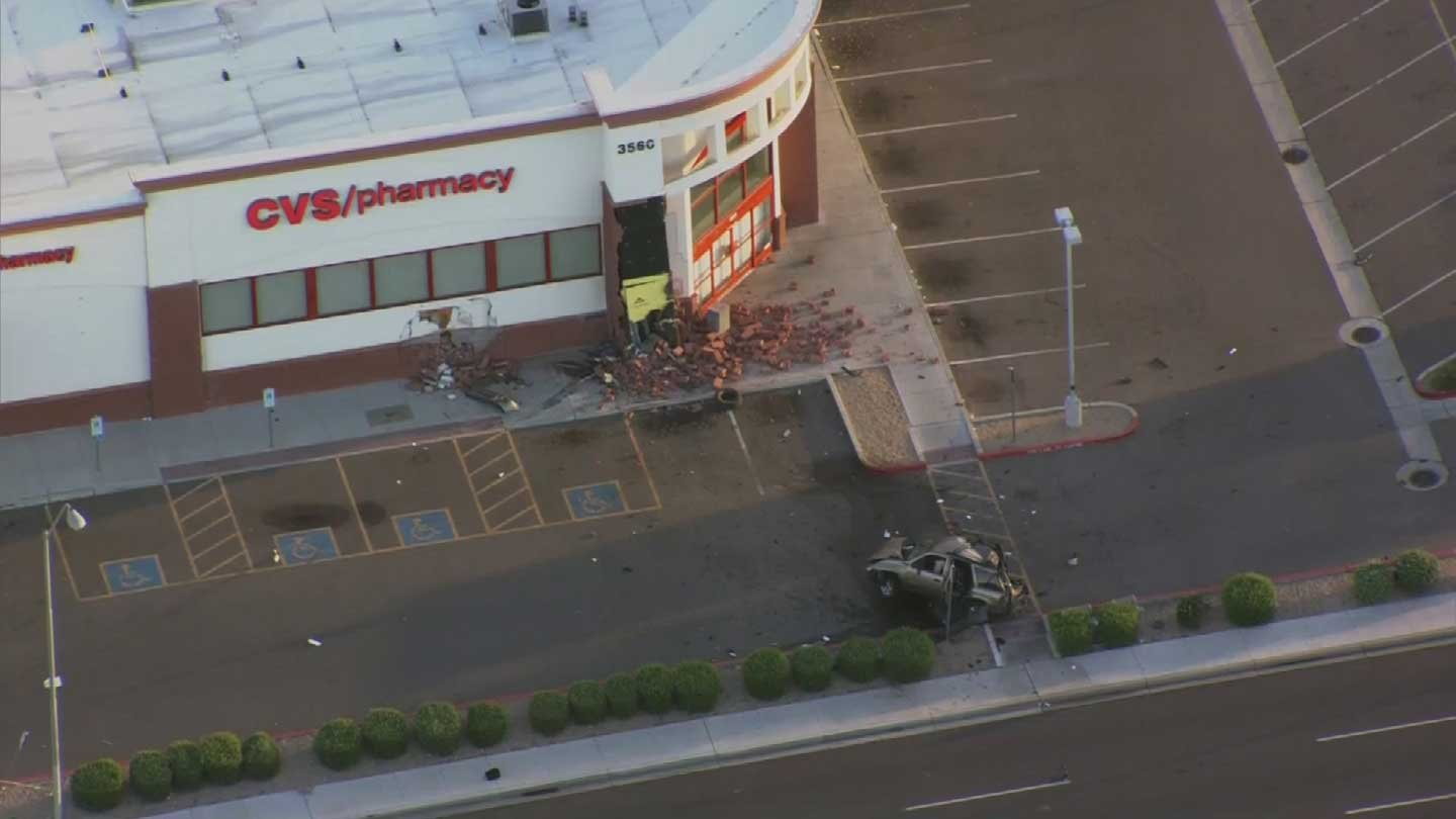 driver seriously injured after vehicle crashes into cvs in phoen